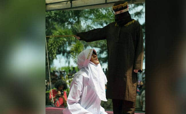 Woman getting caned for Adultery - Crowd cheers at her punishment